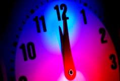 Midnight. Clock with Colored Gel Lighting Stock Photo