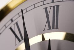 Midnight. Closeup image of clock face approaching midnight stock photo