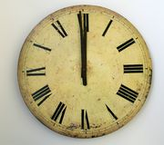 Midnight. Antique looking clock face showing the time. Midnight - happy New Year Stock Image