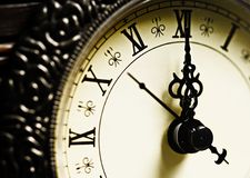 Almost midnight. Antique clock hands showing midnight Stock Photo