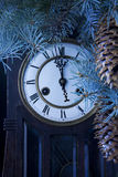 Midnight antique clock and a Christmas tree Stock Photo