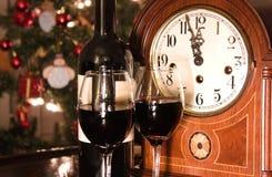Midnight celebration. Wine an clock at midnight Stock Photos