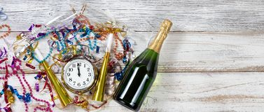 Midnight Celebration for New Year on rustic white table. Celebration at Midnight for New Year with party objects and Champagne stock photography