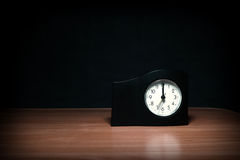 Almost Midnight. Clock in the Dark Room with display Almost Midnight Stock Images
