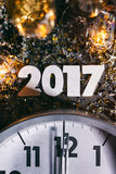 2017 Midnight Clock New Year`s Eve Grunge Background. Gritty images featuring `2017` with decorations, confetti, and more. Space for copy stock image