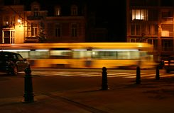 Midnight express tram. Moving yellow tram at night Stock Photos