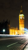 Midnight in London with Big Ben and passing traffi Stock Images