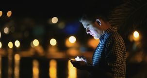 Midnight Man Using Smart Phone Typing Sms. Close-up shot of man typing text message on smart phone. Businessman using mobile phone to make text message stock video footage