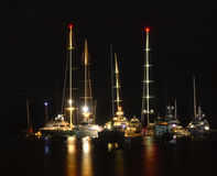 Midnight at the marina. Superyachts, motoryachts & Sailboats populate a tranquil marina at Port Denarau in Fiji in the middle of the night. Water reflectiond of Stock Photos