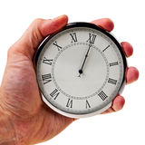 Midnight or noon on retro watch. Midnight or noon on retro watch hold in male hand isolated over white background royalty free stock photos