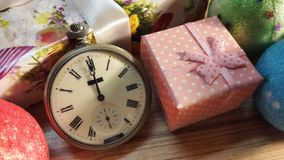 Midnight on the old clock. Old clock  among Christmas gifts Royalty Free Stock Photo
