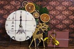Midnight's clock with Christmas deer Stock Photos