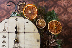 Midnight's clock with dried oranges stock images