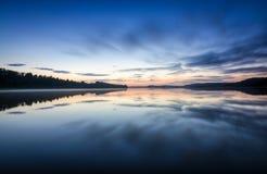 Midnight on Scandinavian lake Stock Photos