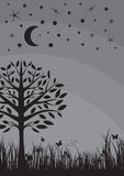Midnight silhouette tree, grass, moon and stars Royalty Free Stock Image