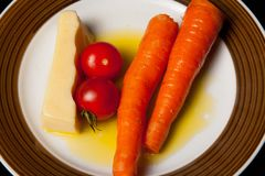 Midnight snack, carrots, tomatoes and cheese, healthy stock image