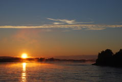 Midnight Sun. Over the border river (the Arctic Circle, Northern Sweden Stock Photo