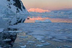Midnight Sun - Antarctica. Midnight sun (3.30am) over sea ice in the Lamaire Channel in Antarctica Royalty Free Stock Photography