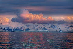 Midnight Sun - Drake Passage - Antarctica. The Midnight sun over the icebergs of the Drake Passage near the Antarctic Peninsula in Antarctica Stock Photo