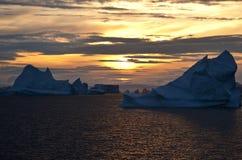Midnight Sun - Greenland. Midnight sun and Icebergs in Scoresbysund in eastern Greenland Stock Image