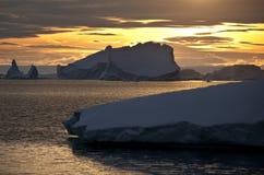 Midnight Sun - Greenland. Midnight sun and Icebergs in Scoresbysund in eastern Greenland Stock Photo