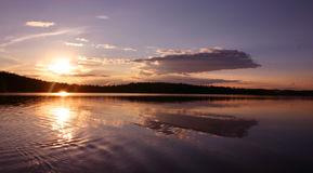 Midnight sun lake. Panorama in colorful summer evening sunset royalty free stock photos