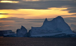 Midnight Sun in Scoresbysund - Greenland. Midnight sun and icebergs in Scoresbysund on the east coast of Greenland Stock Images