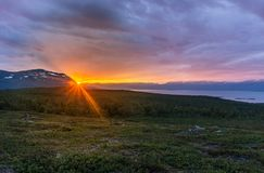 Midnight sun in summer in Abisko National Park, Sweden royalty free stock photo