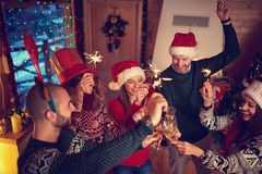 Midnight toasting for New Year. Cheerful friends toasting at New Year`s midnight royalty free stock images
