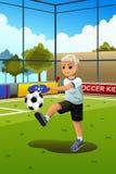 Miúdo que joga o futebol Foto de Stock Royalty Free