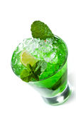 Midori Fizz Cocktail. Green Cocktail with Midori, Vodka, Lime and Ice Royalty Free Stock Images