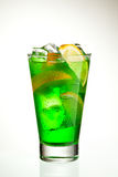 Midori Fizz. Green Cocktail with Midori, Vodka, Lemon and Ice Royalty Free Stock Photo