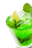 Midori Fizz. Green Cocktail with Midori, Vodka, Lime and Ice Royalty Free Stock Images