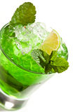 Midori Fizz. Green Cocktail with Midori, Vodka, Lime and Ice Royalty Free Stock Photography
