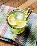 Midori Sour Cocktail with ice and lemon. Stock Photography