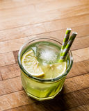 Midori Sour Cocktail with ice and lemon. Royalty Free Stock Photos