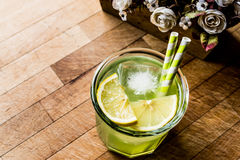 Midori Sour Cocktail with ice and lemon. Stock Images
