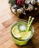 Midori Sour Cocktail with ice and lemon. Stock Image