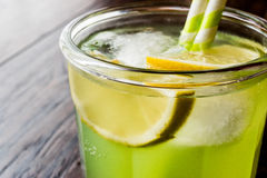 Midori Sour Cocktail with ice and lemon. Royalty Free Stock Photography