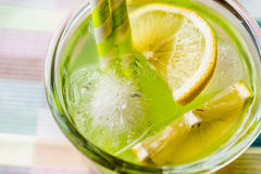 Midori Sour Cocktail with ice and lemon. Royalty Free Stock Photo