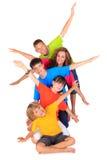 Miúdos com braços Outstretched Foto de Stock Royalty Free