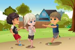 Miúdos que jogam junto Foto de Stock