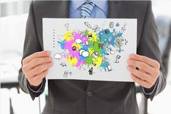 Midsection бизнесмена проводя плакат с различными значками на карте Стоковое Изображение