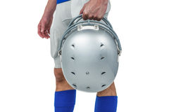 Midsection of American football player handing his helmet. On a white background Royalty Free Stock Photos