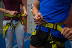 Midsection of athletes adjusting harness Stock Image
