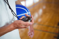 Midsection of basketball coach with stopwatch stock photography