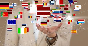 Midsection of business executive with various flags stock photography