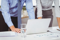 Midsection of business people using laptop Stock Images
