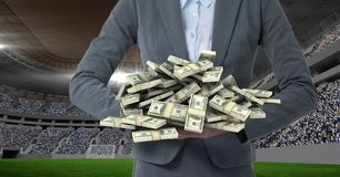 Midsection of business person with money representing corruption. Digital composite of Midsection of business person with money representing corruption royalty free stock image