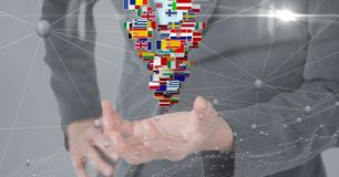 Midsection of business person with various flags and connecting dots stock image